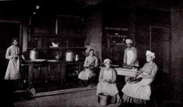 Girls living at the Milwaukee Industrial School for Girls prepare a meal in the late 1800s
